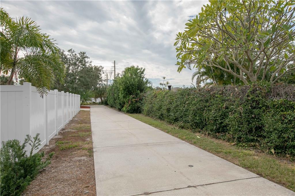 The very long driveway to your private oasis. - Single Family Home for sale at 6213 8th Avenue Dr W, Bradenton, FL 34209 - MLS Number is A4423560