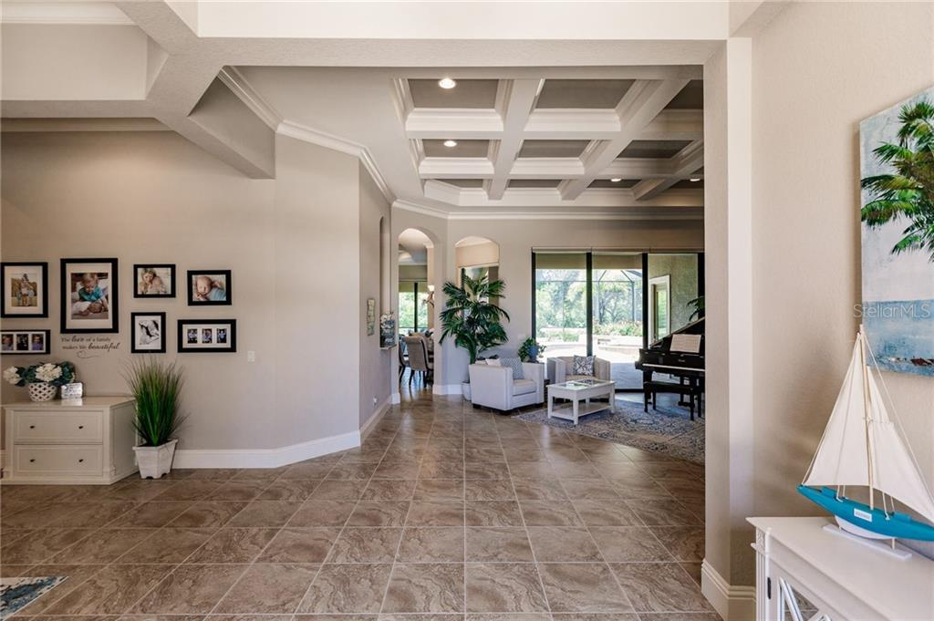 14 foot Coffered Ceilings - Single Family Home for sale at 20 Blake Way, Osprey, FL 34229 - MLS Number is A4423645