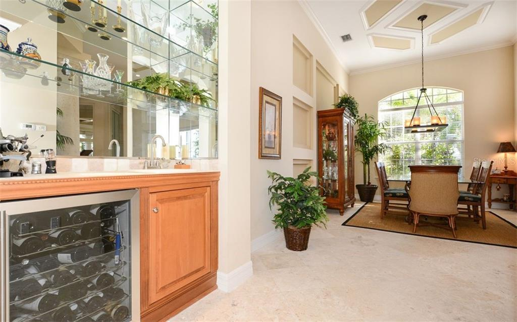 Wet Bar with Wine Refrigerator - Single Family Home for sale at 2522 Tom Morris Dr, Sarasota, FL 34240 - MLS Number is A4423908