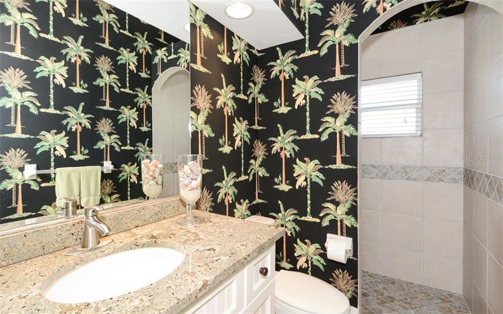 Guest Bath 3 with walk-in Shower - Single Family Home for sale at 2522 Tom Morris Dr, Sarasota, FL 34240 - MLS Number is A4423908