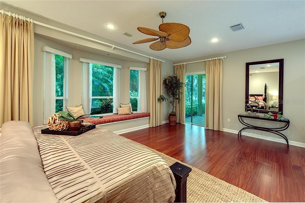 Such a spacious master suite, sliders lead to the tiled back lanai and lushly landscaped back yard. - Single Family Home for sale at 2972 Jeff Myers Cir, Sarasota, FL 34240 - MLS Number is A4424133