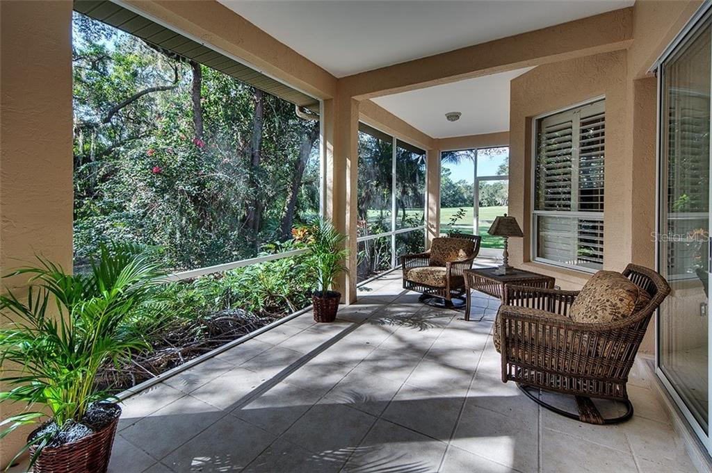 Back lanai - tiled, screened, and what a wonderful way to relax! - Single Family Home for sale at 2972 Jeff Myers Cir, Sarasota, FL 34240 - MLS Number is A4424133