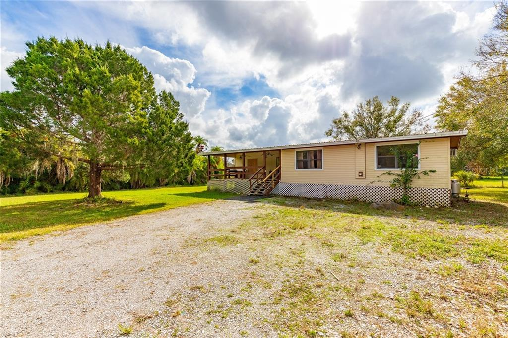 Single Family Home for sale at 5915 77th St E, Palmetto, FL 34221 - MLS Number is A4424348