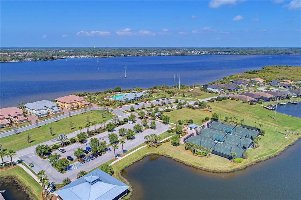 Community Clubhouse, tennis courts and pool overlooking Manatee River - Single Family Home for sale at 5712 Tidewater Preserve Blvd, Bradenton, FL 34208 - MLS Number is A4424693
