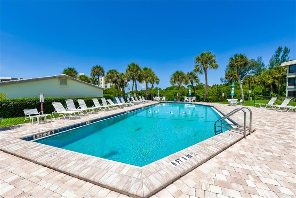 The heated Clubhouse pool - one of 2 pools on the property. - Condo for sale at 225 Hourglass Way #208, Sarasota, FL 34242 - MLS Number is A4425323