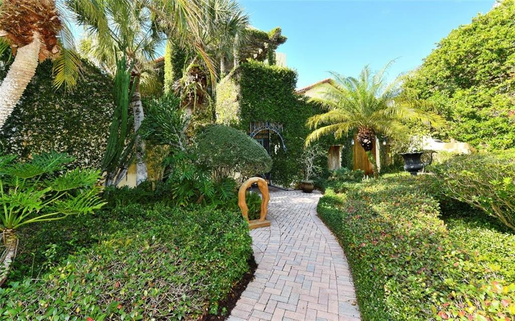 Relax on your beach hammock and enjoy the tropical breezes - Single Family Home for sale at 121 N Casey Key Rd, Osprey, FL 34229 - MLS Number is A4425715
