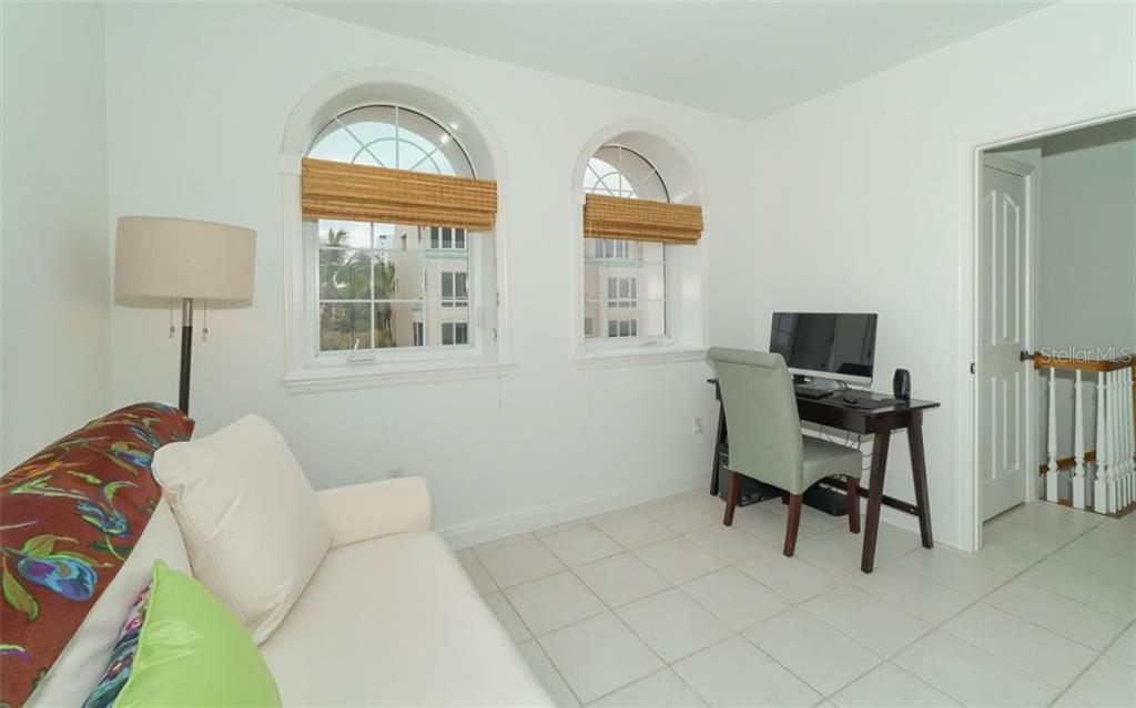 Second bedroom with windows overlooking the front of the property. - Condo for sale at 1283 Fruitville Rd #a, Sarasota, FL 34236 - MLS Number is A4426039