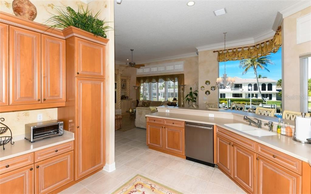 Kitchen overlooks the canal, family room and kitchen Dinette.  Notice the Lq. Crown Moldings thriugh-out the home. - Single Family Home for sale at 561 Ketch Ln, Longboat Key, FL 34228 - MLS Number is A4426280