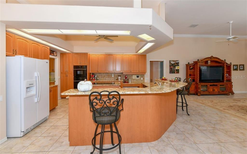 The large kitchen is great for entertaining! - Single Family Home for sale at 7867 Estancia Way, Sarasota, FL 34238 - MLS Number is A4426528