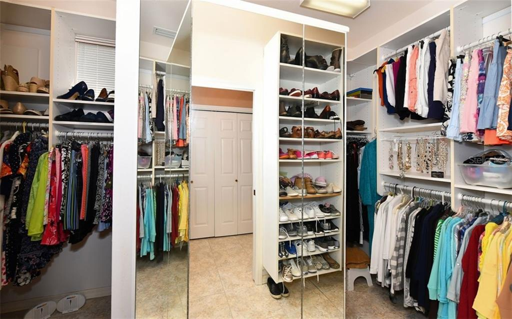 Large walk in closet.  This home has so much closet space! - Single Family Home for sale at 7867 Estancia Way, Sarasota, FL 34238 - MLS Number is A4426528