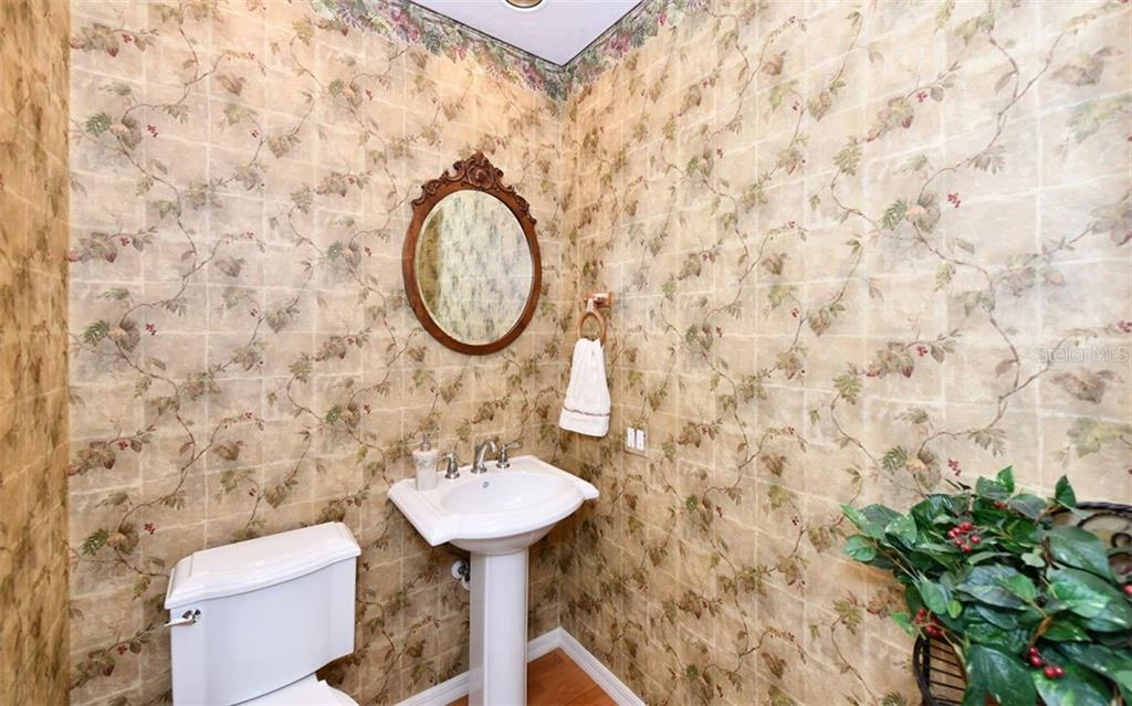 Powder Room off the living room and den - Single Family Home for sale at 7867 Estancia Way, Sarasota, FL 34238 - MLS Number is A4426528