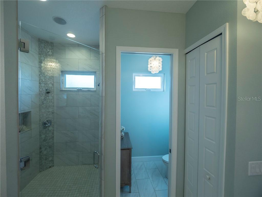 Frameless 8 foot tall glass shower door and large water closet - Single Family Home for sale at 3611 4th Ave Ne, Bradenton, FL 34208 - MLS Number is A4426978
