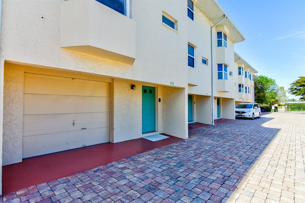 Front door and 2 car tandem garage with direct entry into home - Condo for sale at 773 Benjamin Franklin Dr #7, Sarasota, FL 34236 - MLS Number is A4427752
