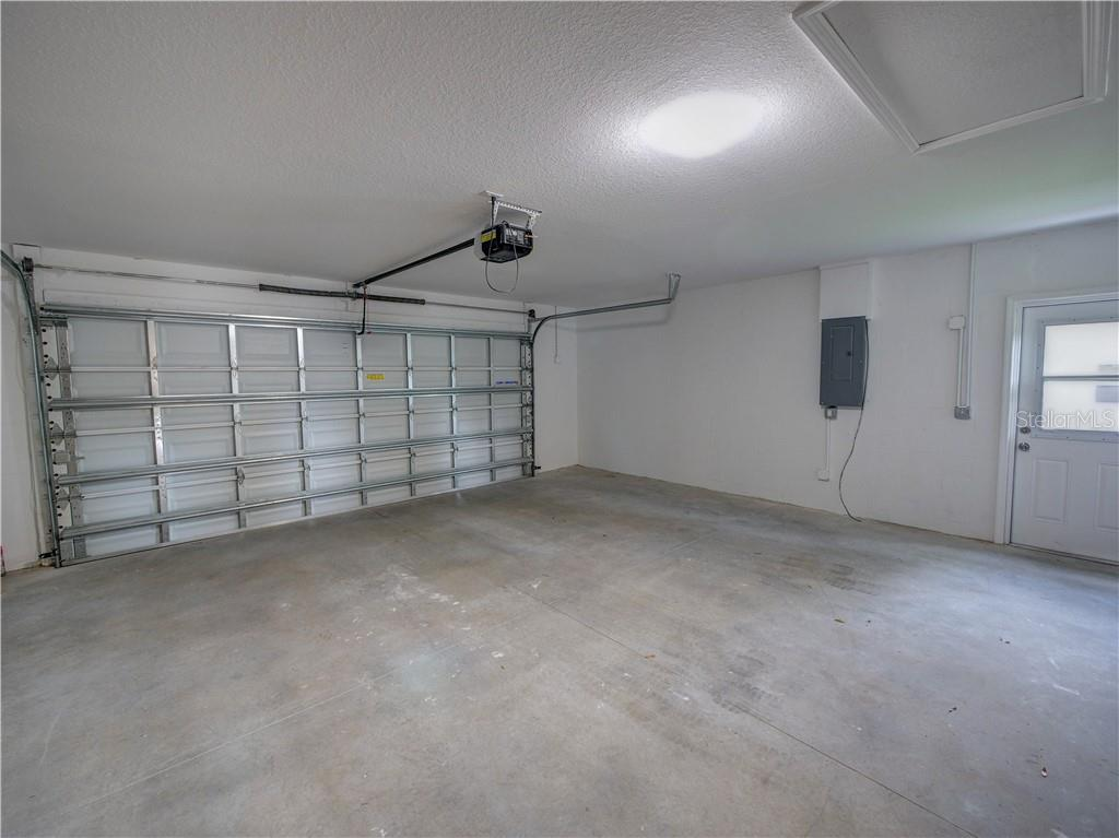 Oversized garage extra storage space and room for vehicles. - Single Family Home for sale at 2558 Oneida Rd, Venice, FL 34293 - MLS Number is A4428145