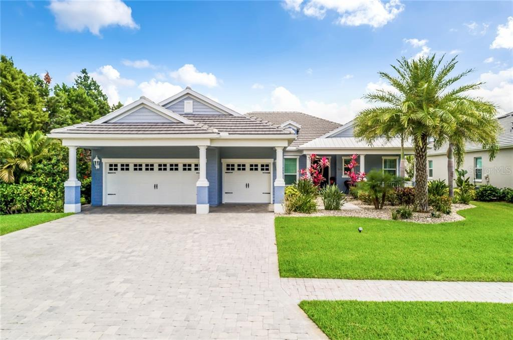 Fiber Cement siding is a long lasting feature of the home along with the tile roof mixed with metal roofing. - Single Family Home for sale at 595 Fore Dr, Bradenton, FL 34208 - MLS Number is A4428657