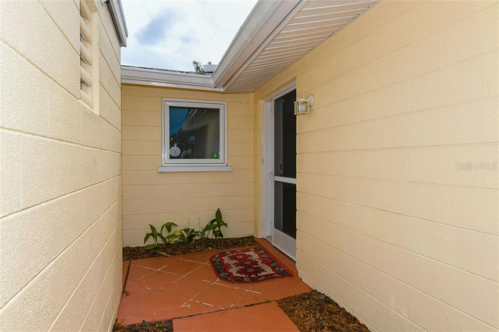 Front Door Entrance - Single Family Home for sale at 2424 Terry Ln, Sarasota, FL 34231 - MLS Number is A4429030