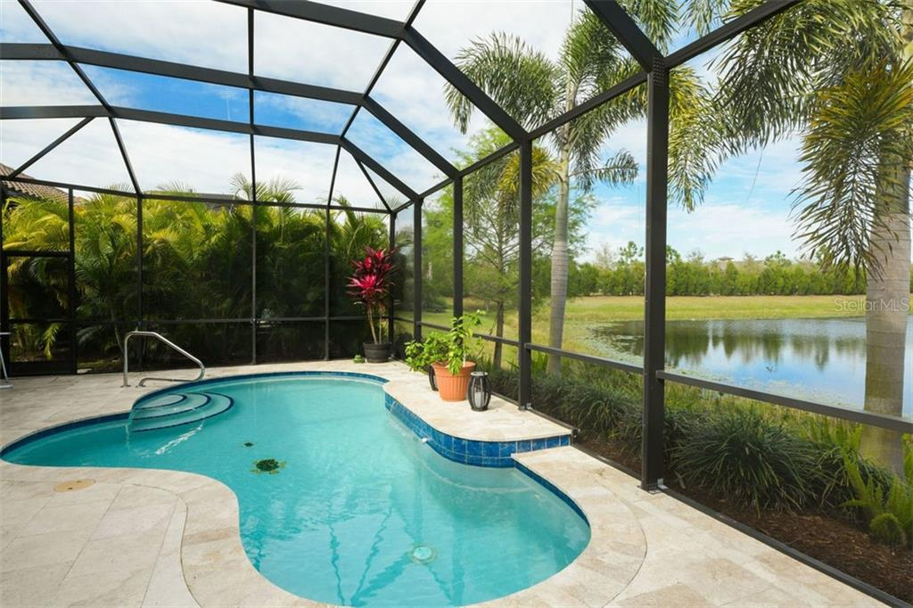 Single Family Home for sale at 7513 Windy Hill Cv, Lakewood Ranch, FL 34202 - MLS Number is A4429392