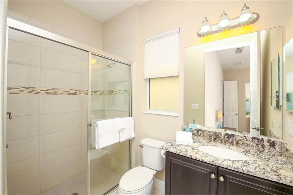 Walk-in Shower in full bath 2 - Single Family Home for sale at 5504 Tidewater Preserve Blvd, Bradenton, FL 34208 - MLS Number is A4429479