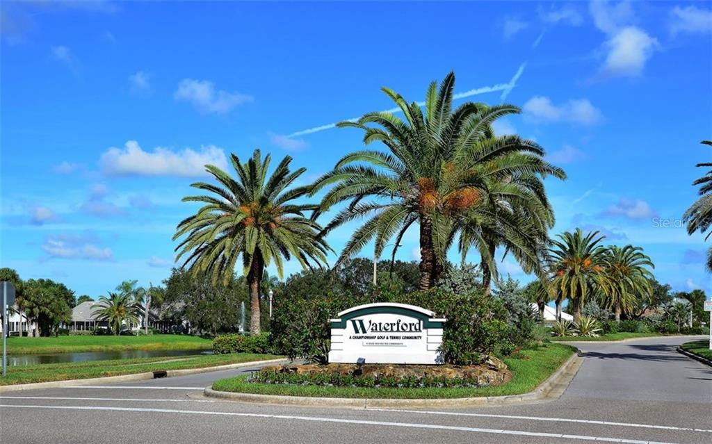 Waterfords well maintained entrance is welcoming! All resident streets are gated. - Single Family Home for sale at 1636 Liscourt Dr, Venice, FL 34292 - MLS Number is A4429524