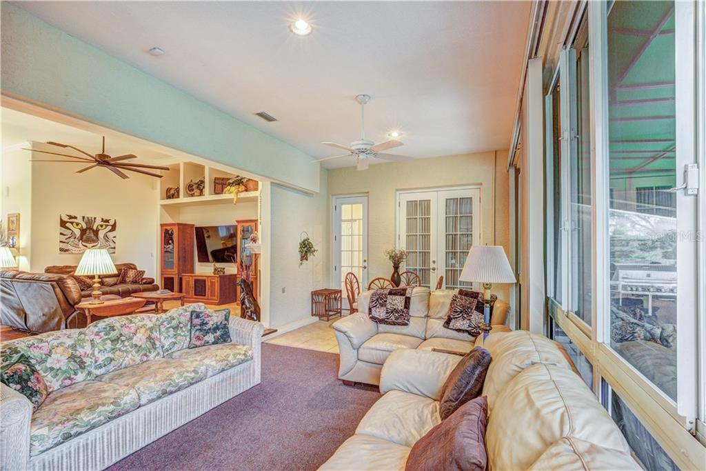 Large glass walled florida room that opens to 1200 sq ft screened patio - Single Family Home for sale at 6321 W Glen Abbey Ln E, Bradenton, FL 34202 - MLS Number is A4429610