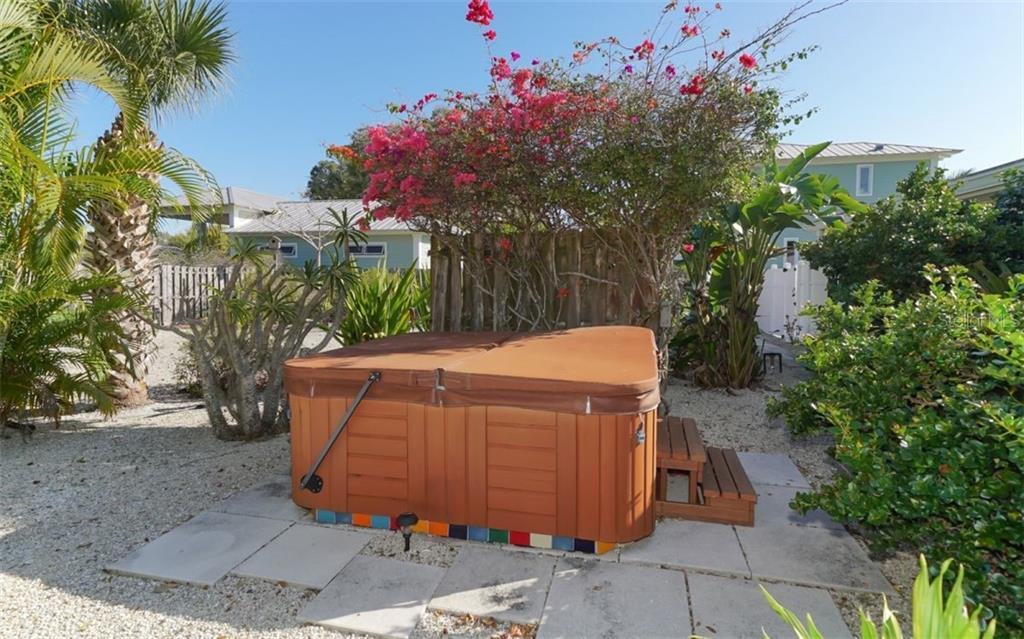 5-Person Hot Springs hot tub with insulated cover and lifting bar. - Single Family Home for sale at 310 Bayview Pkwy, Nokomis, FL 34275 - MLS Number is A4430065