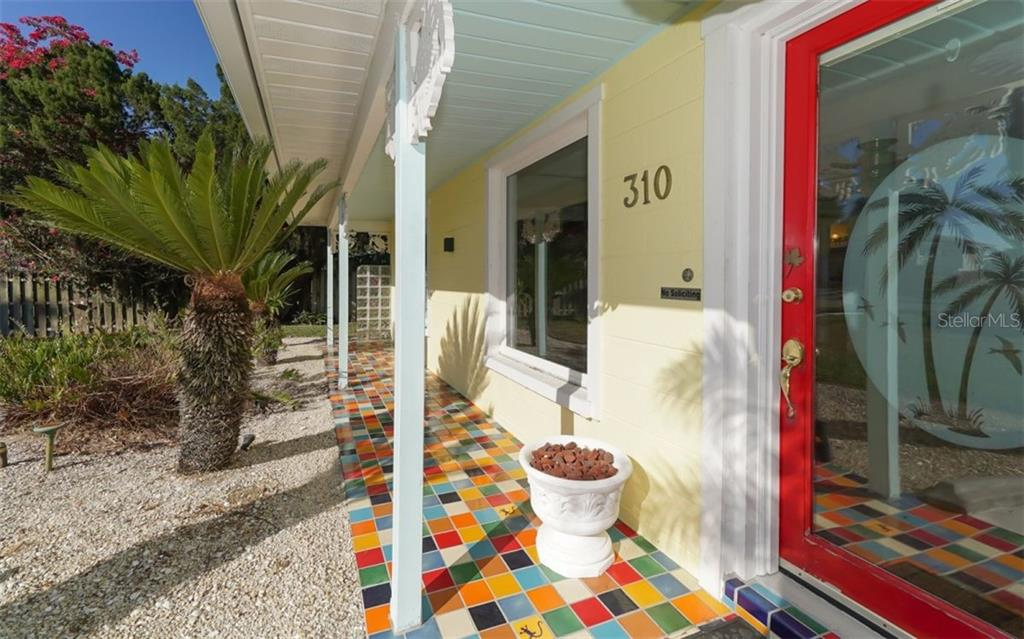 Colorful Italian tiles & glass French door with tropical inset will greet your many Florida guests. - Single Family Home for sale at 310 Bayview Pkwy, Nokomis, FL 34275 - MLS Number is A4430065
