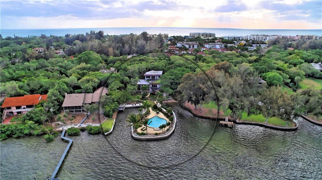 Aerial view of the vast property with big views of the bay. - Single Family Home for sale at 6841 Peacock Rd, Sarasota, FL 34242 - MLS Number is A4430828