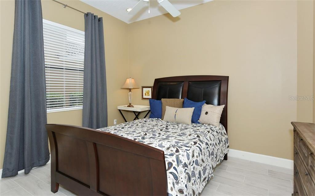 Bedroom 3 - Single Family Home for sale at 14231 Sundial Pl, Lakewood Ranch, FL 34202 - MLS Number is A4430945