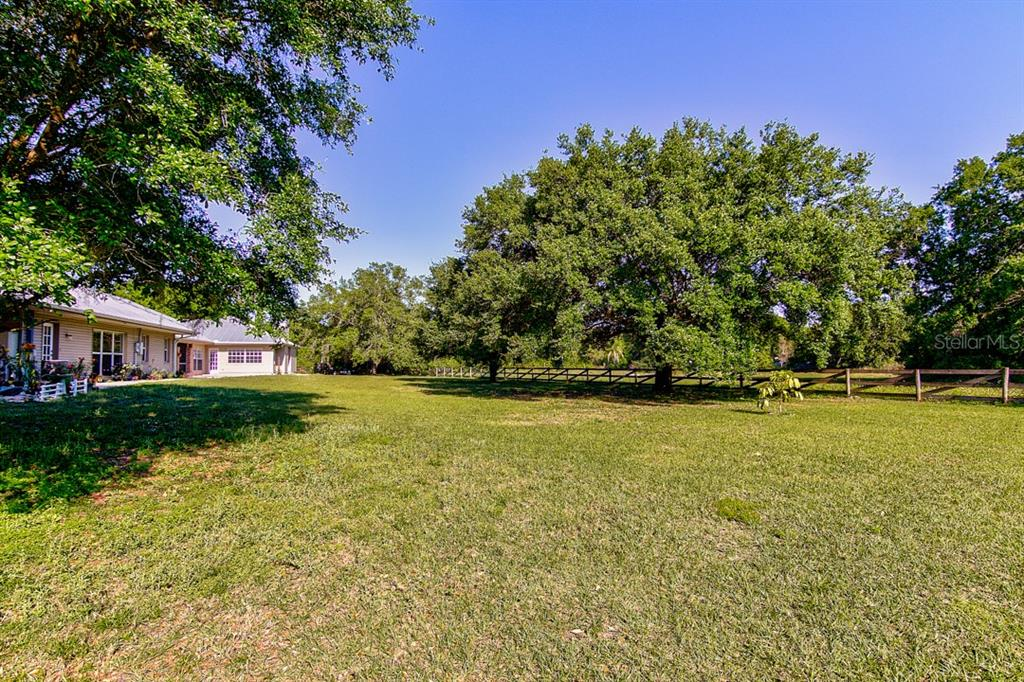 Majestic oak trees grace this property - Single Family Home for sale at 7945 Palmer Blvd, Sarasota, FL 34240 - MLS Number is A4431318