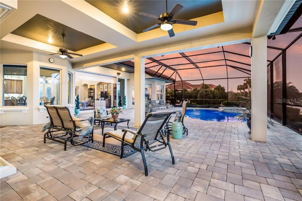 Brick paver pool deck with numerous seating areas. - Single Family Home for sale at 19432 Newlane Pl, Bradenton, FL 34202 - MLS Number is A4432094