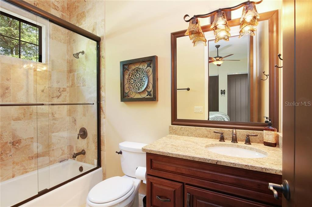 ensuite bathroom for guest bedroom 1 - Single Family Home for sale at 1813 Boyce St, Sarasota, FL 34239 - MLS Number is A4433125