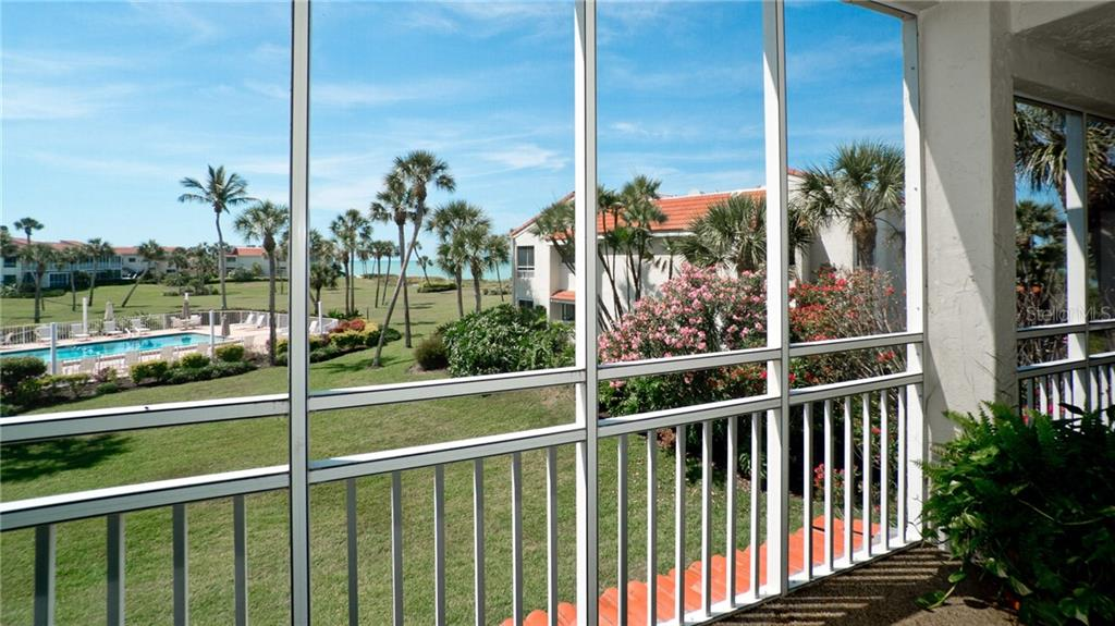 Spacious lanai overlooking the heated pool & beautiful grounds - Condo for sale at 7145 Gulf Of Mexico Dr #24, Longboat Key, FL 34228 - MLS Number is A4433880