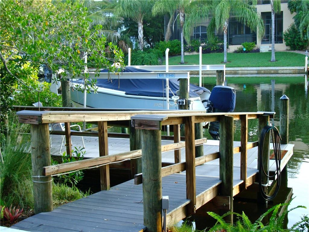 Deepwater dock with a 7000lb lift and a ladder for easy access to kayaking and paddle boating. - Single Family Home for sale at 5143 Oxford Dr, Sarasota, FL 34242 - MLS Number is A4434790