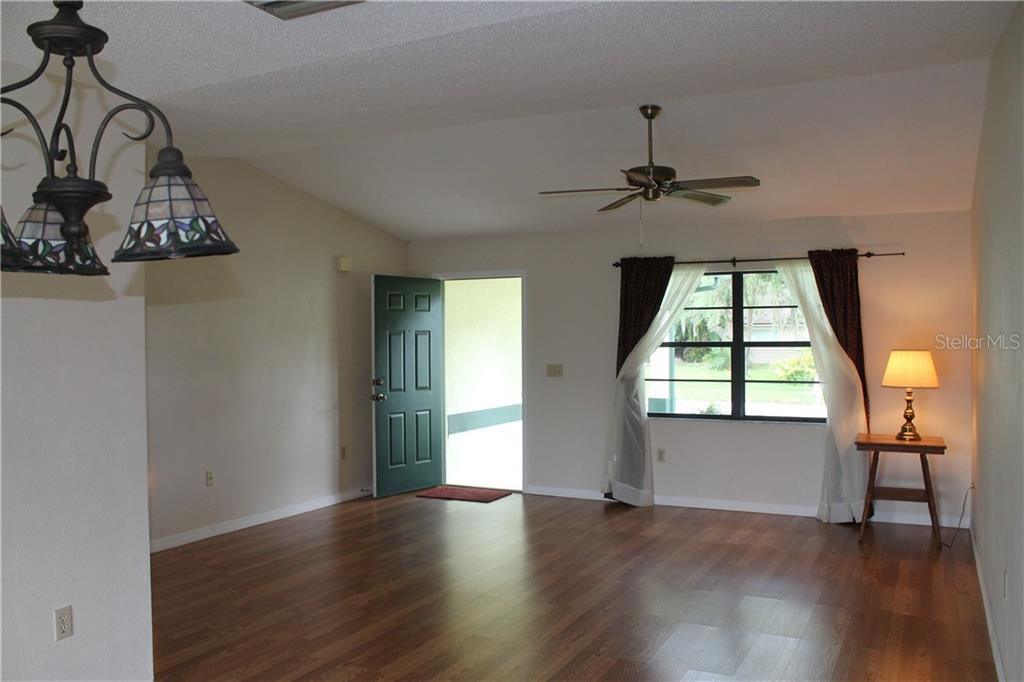 Spacious great room with vaulted ceilings.  A very light and airy space. - Single Family Home for sale at 4803 Glenbrooke Dr, Sarasota, FL 34243 - MLS Number is A4435920