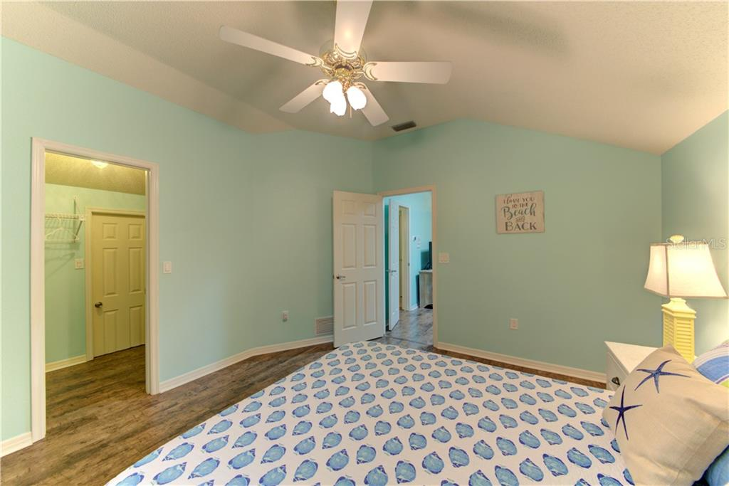 Bedroom 3 with walk-in closet. Additional storage in the closet. - Single Family Home for sale at 1202 N View Dr, Sarasota, FL 34242 - MLS Number is A4436092