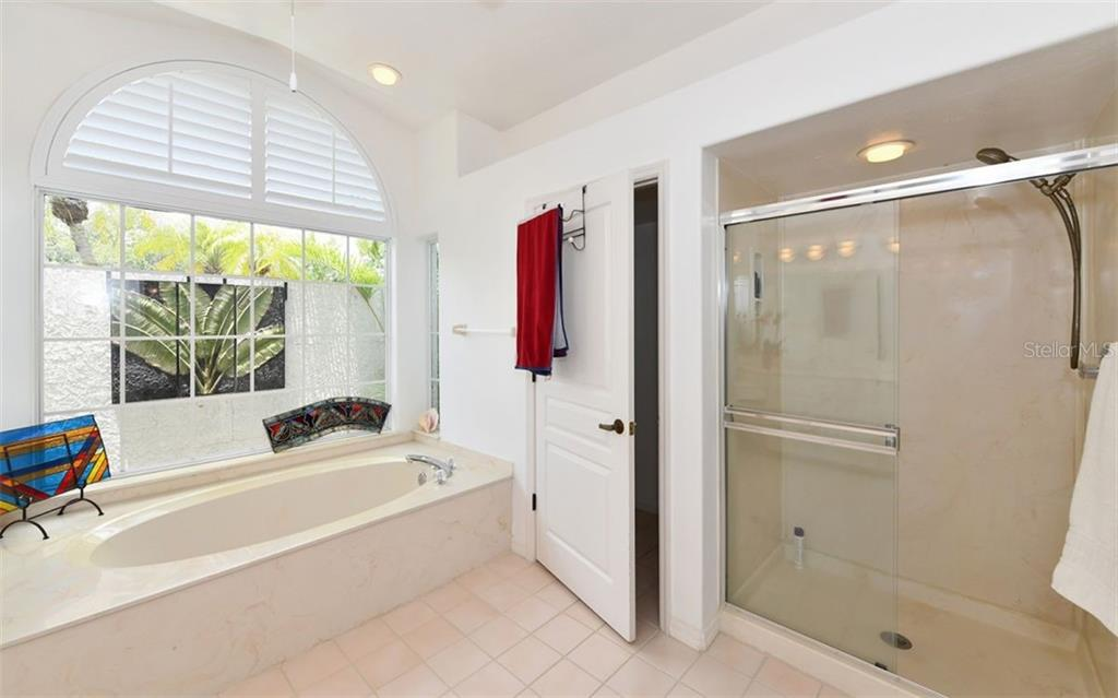 Step in Shower, Commode and Garden tub - Single Family Home for sale at 5401 Downham Meadows, Sarasota, FL 34235 - MLS Number is A4436577