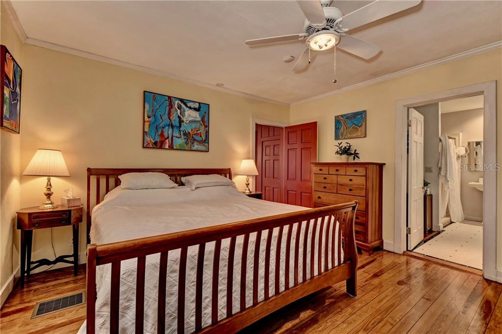 Bright but intimate master bedroom with gorgeous hardwood floors and a spacious, full, ensuite bathroom. - Single Family Home for sale at 813 Hudson Ave, Sarasota, FL 34236 - MLS Number is A4437601