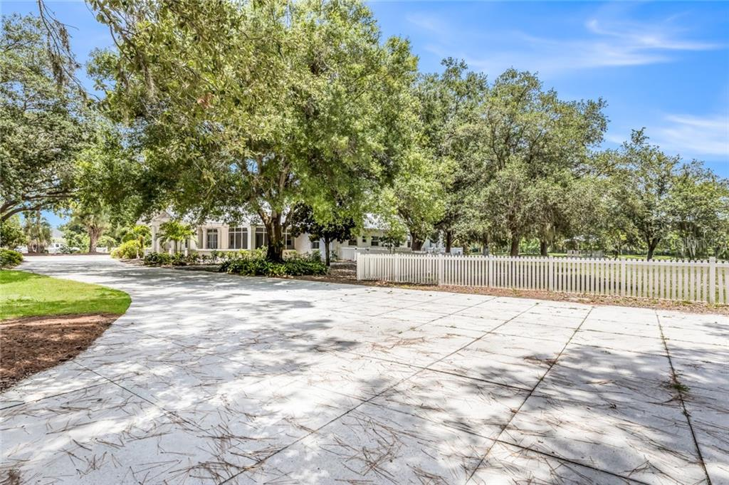 Circular driveway with canopy of magnificent oaks .Bring all the vehicles you like plenty of room! - Single Family Home for sale at 1810 21st St W, Palmetto, FL 34221 - MLS Number is A4438160