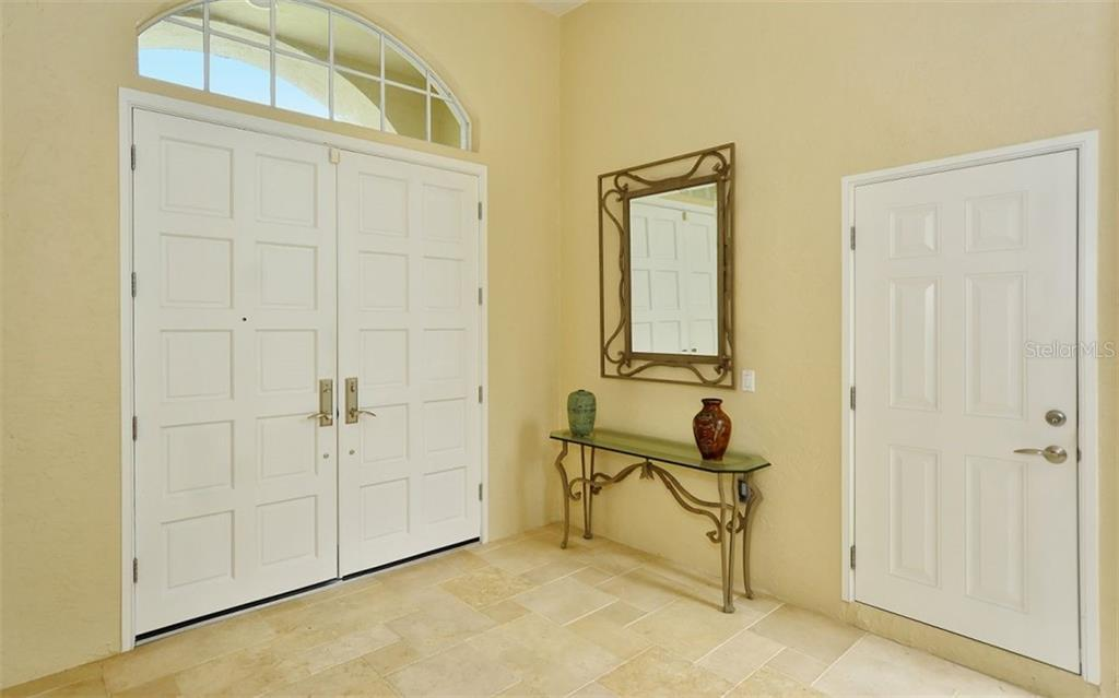 Double front doors to outside. Single door to separate guest suite. - Single Family Home for sale at 6301 Thorndon Cir, University Park, FL 34201 - MLS Number is A4438968