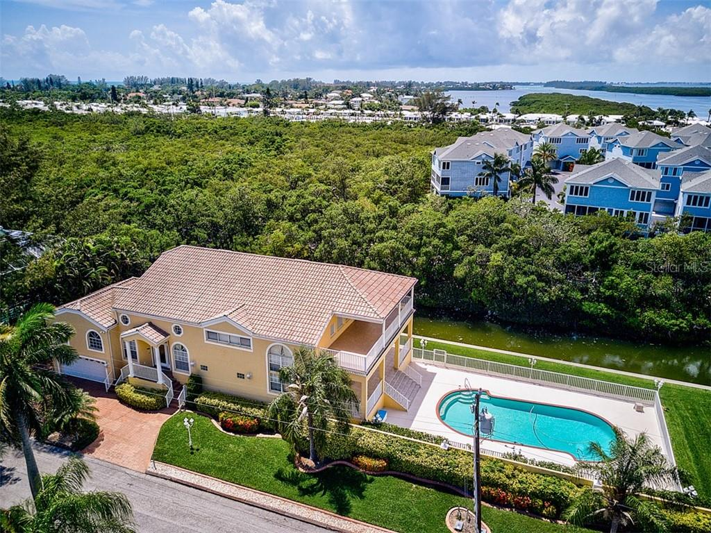 Aerial of front view - Single Family Home for sale at 811 Jungle Queen Way, Longboat Key, FL 34228 - MLS Number is A4438987