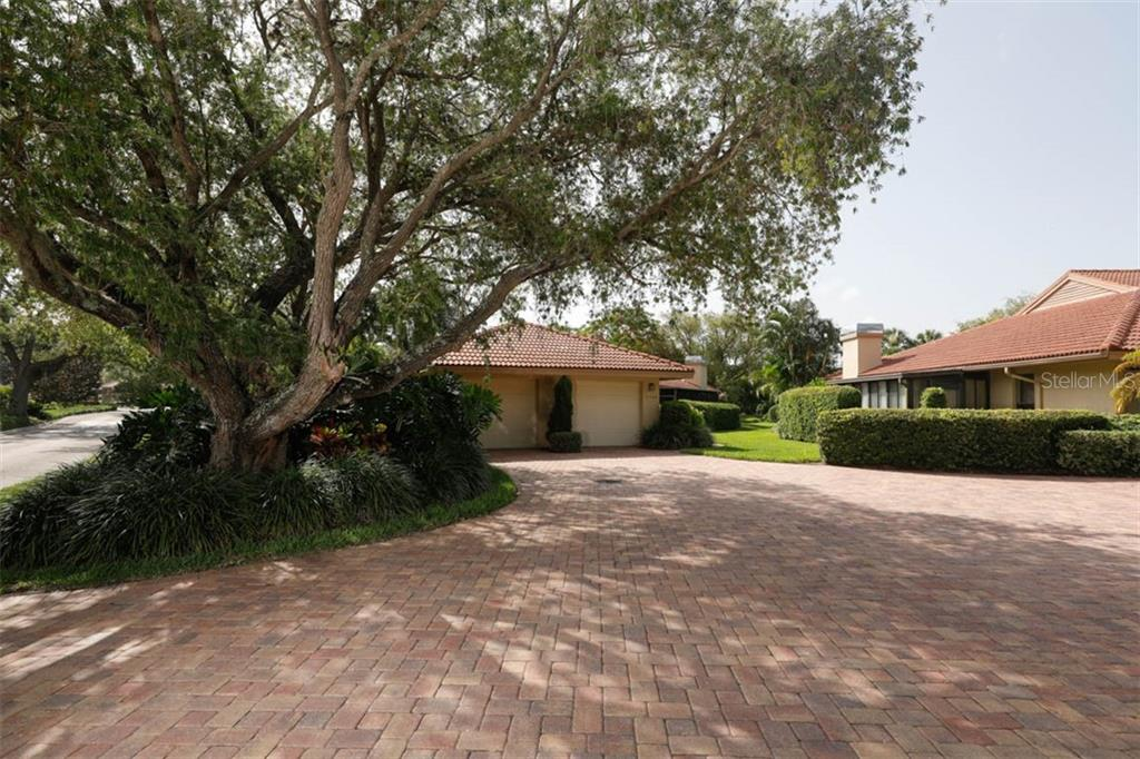 Single car garage on the right. - Condo for sale at 1742 Landings Blvd #38, Sarasota, FL 34231 - MLS Number is A4439252