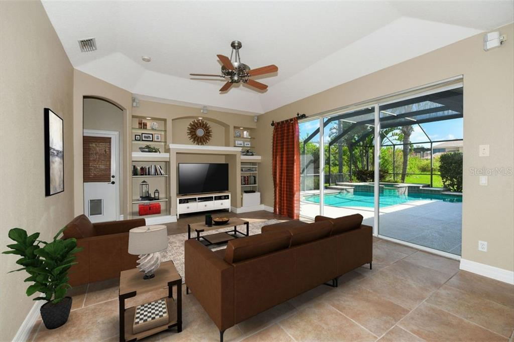 Family Room - Single Family Home for sale at 7843 Crest Hammock Way, Sarasota, FL 34240 - MLS Number is A4439339
