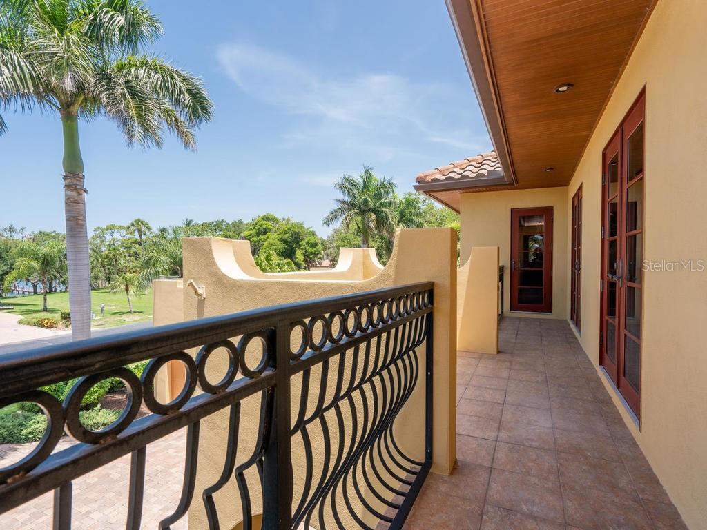 Balcony off of great room and upstairs bedrooms - Single Family Home for sale at 158 Puesta Del Sol, Osprey, FL 34229 - MLS Number is A4439362