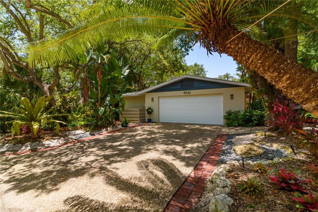 Side entry 2 car attached garage - Single Family Home for sale at 8511 Heron Lagoon Cir, Sarasota, FL 34242 - MLS Number is A4439489