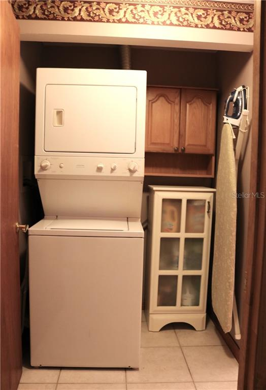 Laundry is currently housed in the 3rd bathroom, with a door to the hall leading to kitchen. - Single Family Home for sale at 2220 Pine Ter, Sarasota, FL 34231 - MLS Number is A4440562