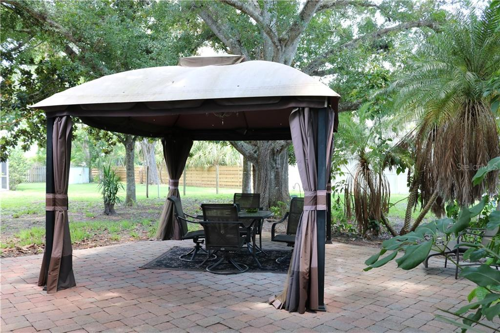 Beautifully landscaped patio with a gazebo that even has a chandelier for your outdoor dinner parties. - Single Family Home for sale at 2220 Pine Ter, Sarasota, FL 34231 - MLS Number is A4440562