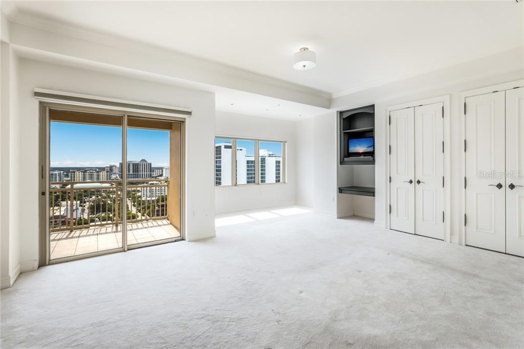 The second bedroom is oversized and has its own balcony overlooking the city. - Condo for sale at 1111 Ritz Carlton Dr #1704, Sarasota, FL 34236 - MLS Number is A4442192