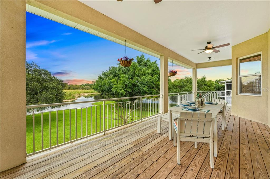 Main Level Covered Balcony and Deck - Single Family Home for sale at 6532 Lincoln Rd, Bradenton, FL 34203 - MLS Number is A4444732