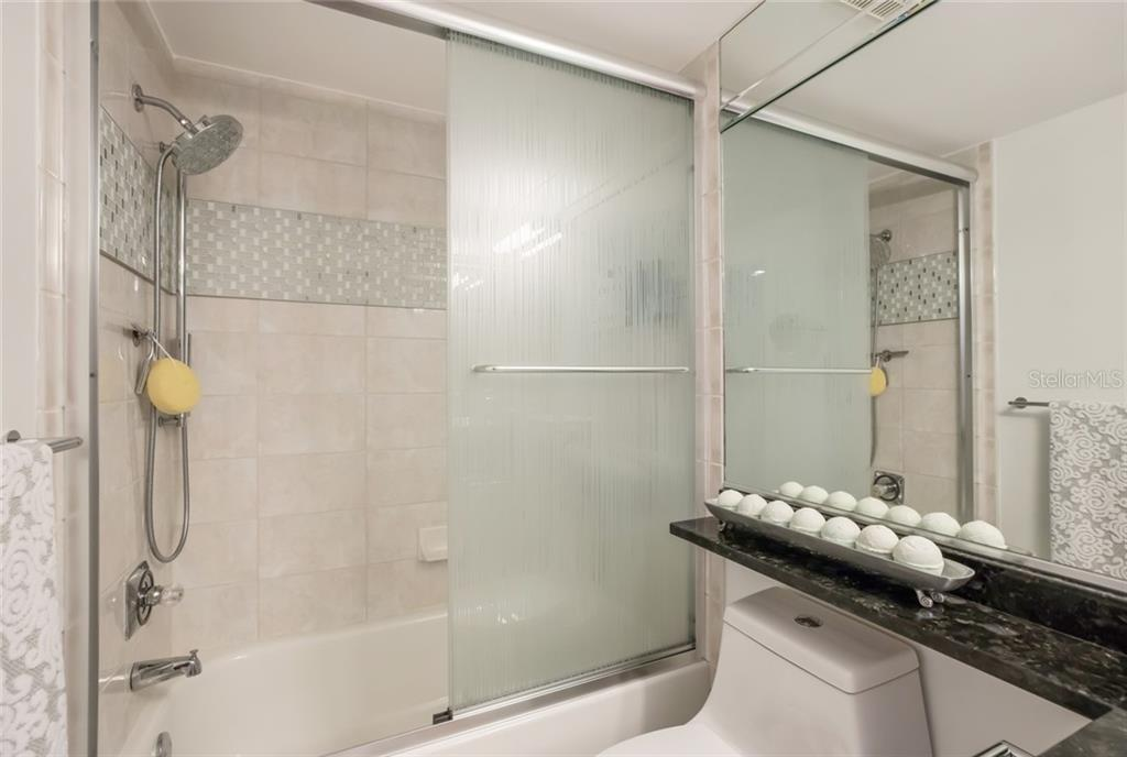 Guest Bath 2. - Condo for sale at 1800 Benjamin Franklin Dr #B408, Sarasota, FL 34236 - MLS Number is A4444789
