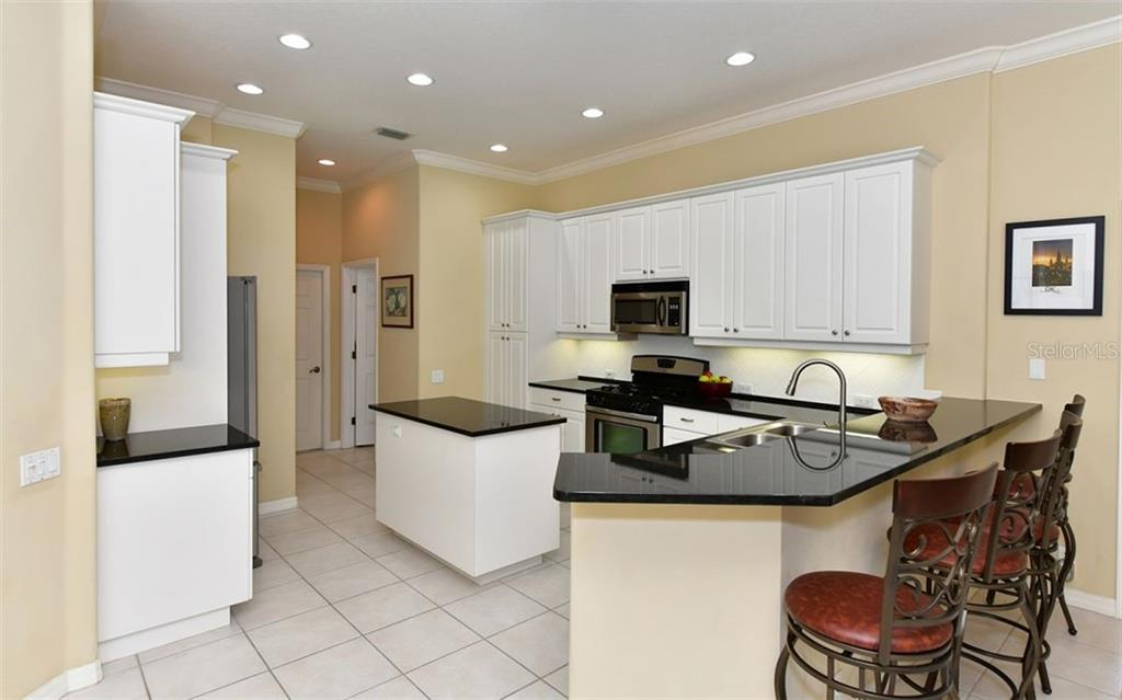 Beautiful kitchen featuring 42' white cabinetry, stainless appliances and new granite countertops. - Single Family Home for sale at 13022 Peregrin Cir, Bradenton, FL 34212 - MLS Number is A4444939